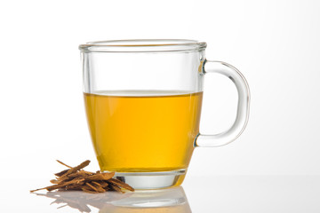 A cup of tea with cinnamon pieces