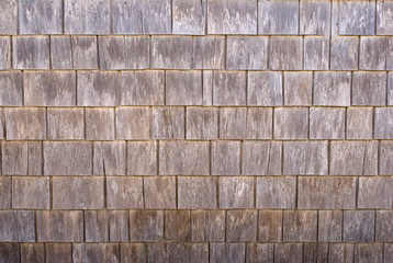 Weathered cedar wood siding shingles, texture, background