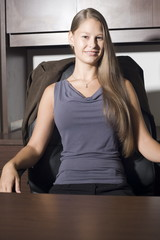 woman executive sitting in chair