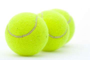 Yellow tennis balls on white - Focus on first ball