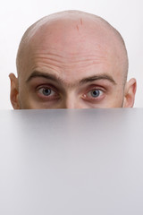 Man peering over a cubicle