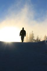 Man walking down a mountain