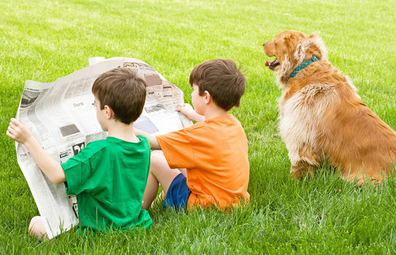 Two Boys Reading the Newspaper
