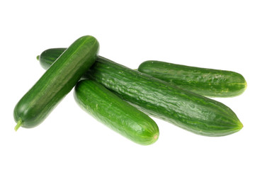 Four cucumbers on white.
