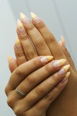 Gel nails with design.