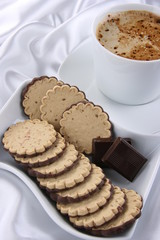 Cappuccino with chocolade cakes on the white background