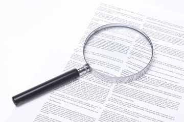 Fototapeta Magnifying glass lying on a legal contract