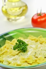 Pasta and sauce with herbs