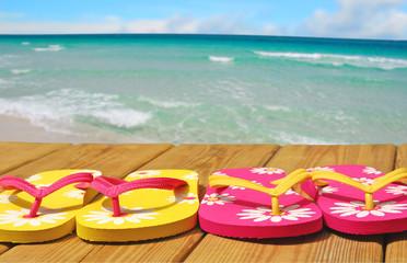 Sandals on Boardwalk by Ocean