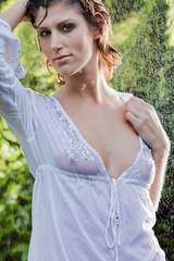 brunette in white blouse standing in the rain
