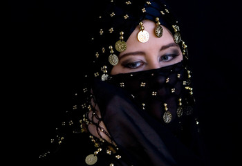 Mysterious eastern woman in black veil
