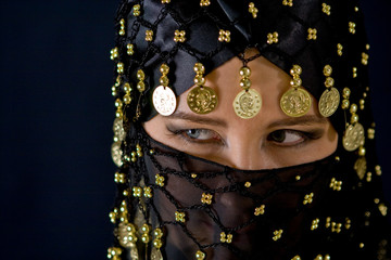 Mysterious eastern woman in black veil