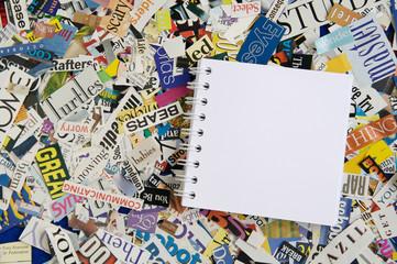Notepad on Magazine Clipping Background