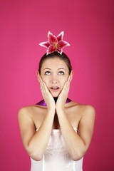 funny beauty portrait of a woman with a flower on her haid