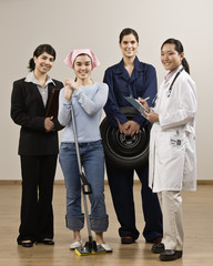 Young women dressed in various occupational clothing