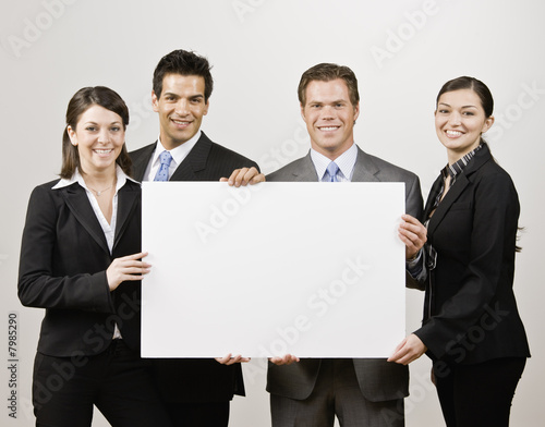 business people holding blank poster board stock photo and royalty