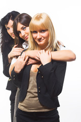 Three beautiful women friends posing