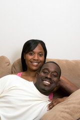 Happy Couple on a Couch. Vertical