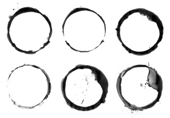 Coffee cup stains made with black ink. Scanned at high res.