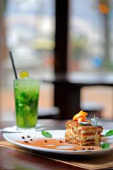 Tiramisu cake and mojito drink
