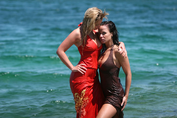 Two sexy girls getting wet in water