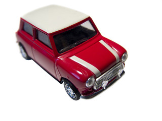 A red mini toy car isolated on white