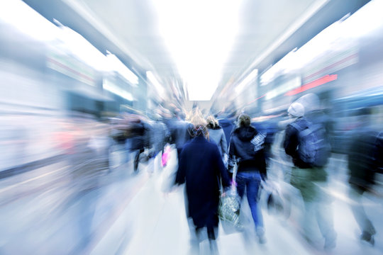 abstract zooming passengers in subway