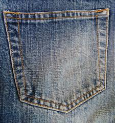 rear pocket of blue jeans