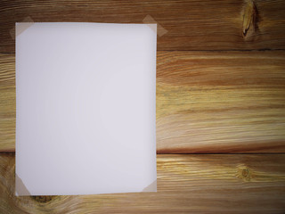 Blank paper on wooden background.