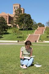 Female student studies for classes