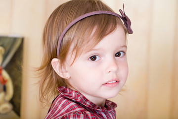 Portrait of a little girl with bow knot on head