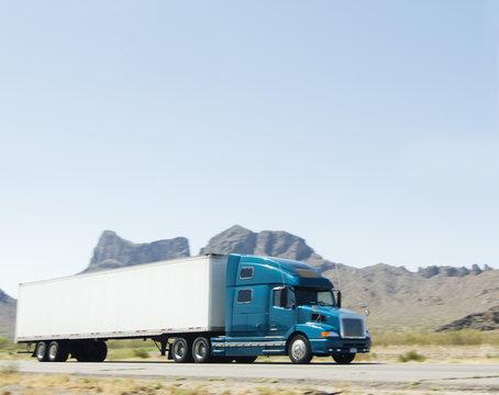 Truck driving through south west desert of Arizona
