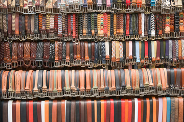 Belts hang down in a row for sale