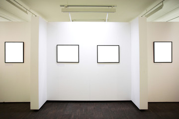 wall in museum with frames