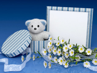 teddy bear gift with a photo frame and flowers