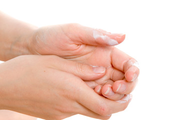 Female hands massage with a cream