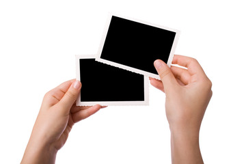 Hands holding a photograph isolated on a white background.