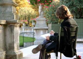 Girl drawing something in her sketchbook