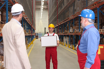 workers in storehouse