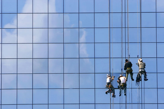 window washers on glass building facade
