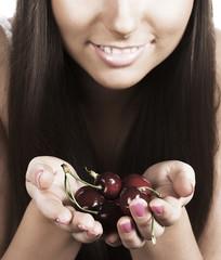 Brunette holding cherries