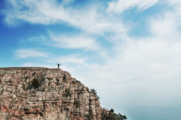 Man on the rocky cliff