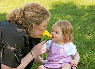 Mom and Daughter Smelling a Flower