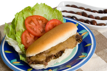 Roast Beef Roll and Salad over white background
