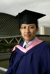 Asian graduate outdoors in Singapore