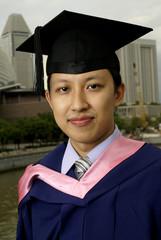 Asian graduate outdoors