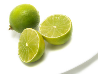 Fresh limes on plate