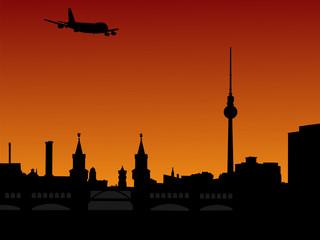 plane flying over Berlin skyline