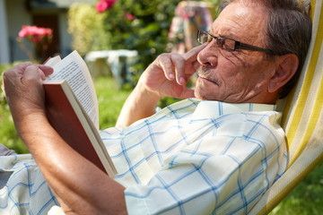 Old man reading outdoor