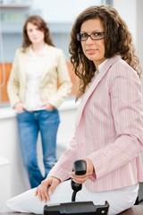 Businesswoman holding phone